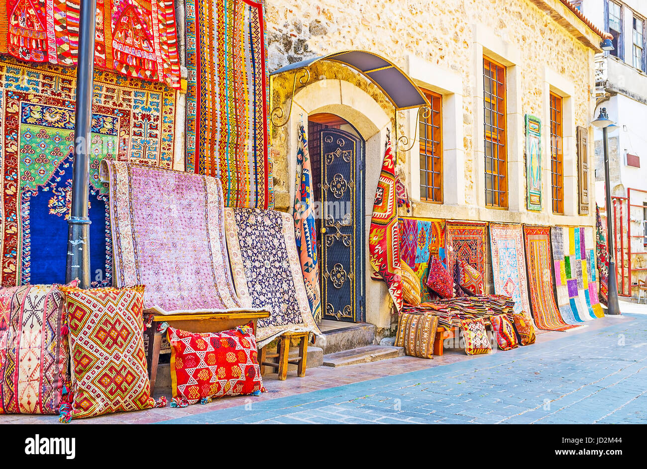 The rug stores of Antalya offer the wide range of silk, wool, cotton and synthetic carpets, decorated with traditional - Stock Image