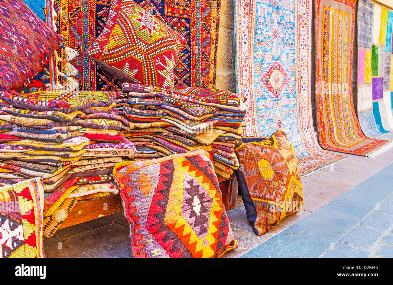 The kilim rug wool pillowcases, covered with traditional geometric patterns, are perfect details for interior design, - Stock Image