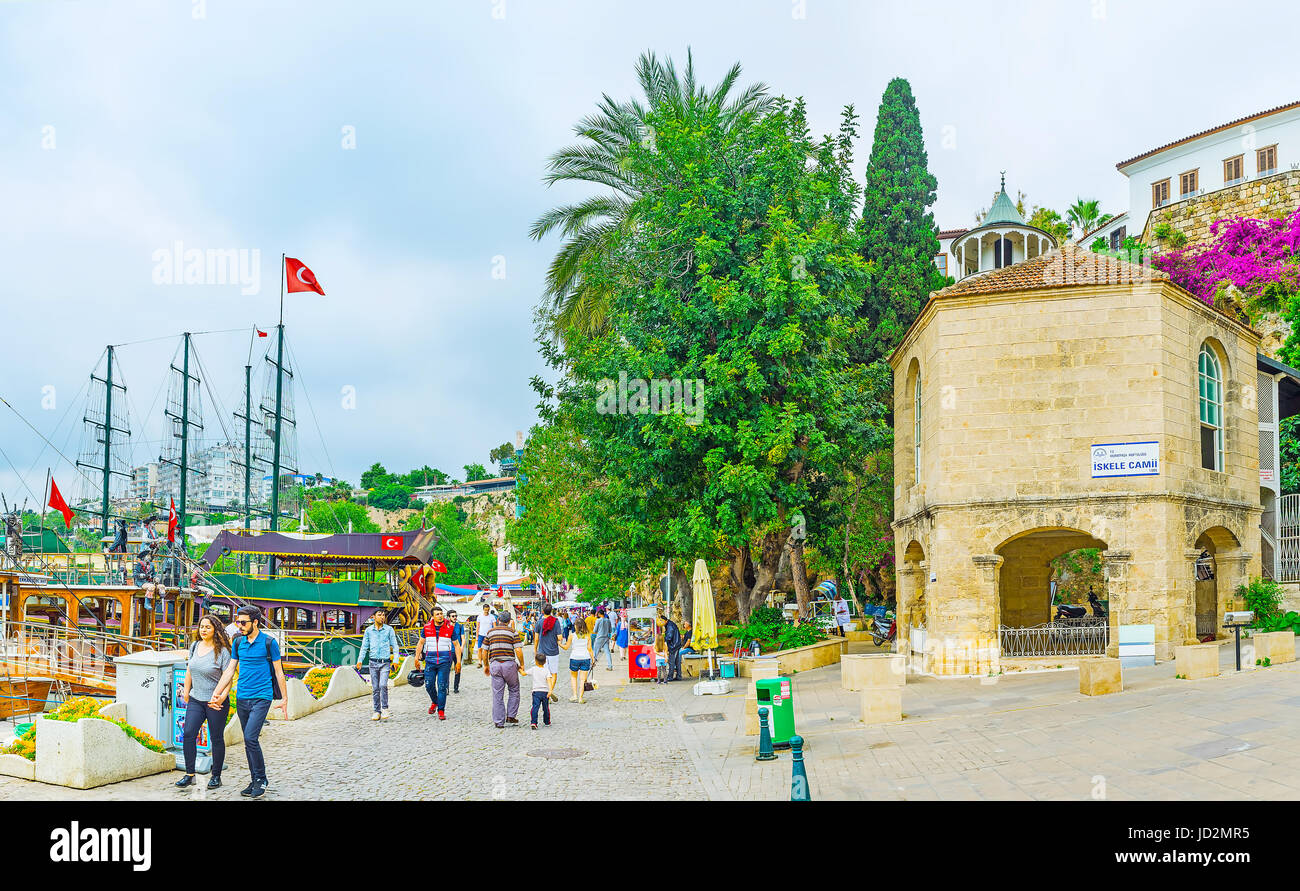 ANTALYA, TURKEY - MAY 6, 2017: The tiny mosque Iskele Camii is hidden among the green trees in old marina, on May - Stock Image