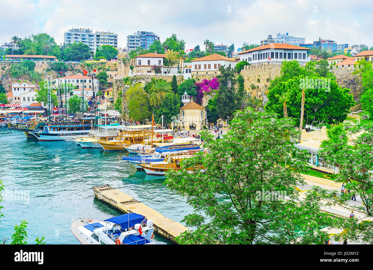 The view of old port with the Iskele Mosque, located next to the old fortress wall, Antalya, Turkey. - Stock Image