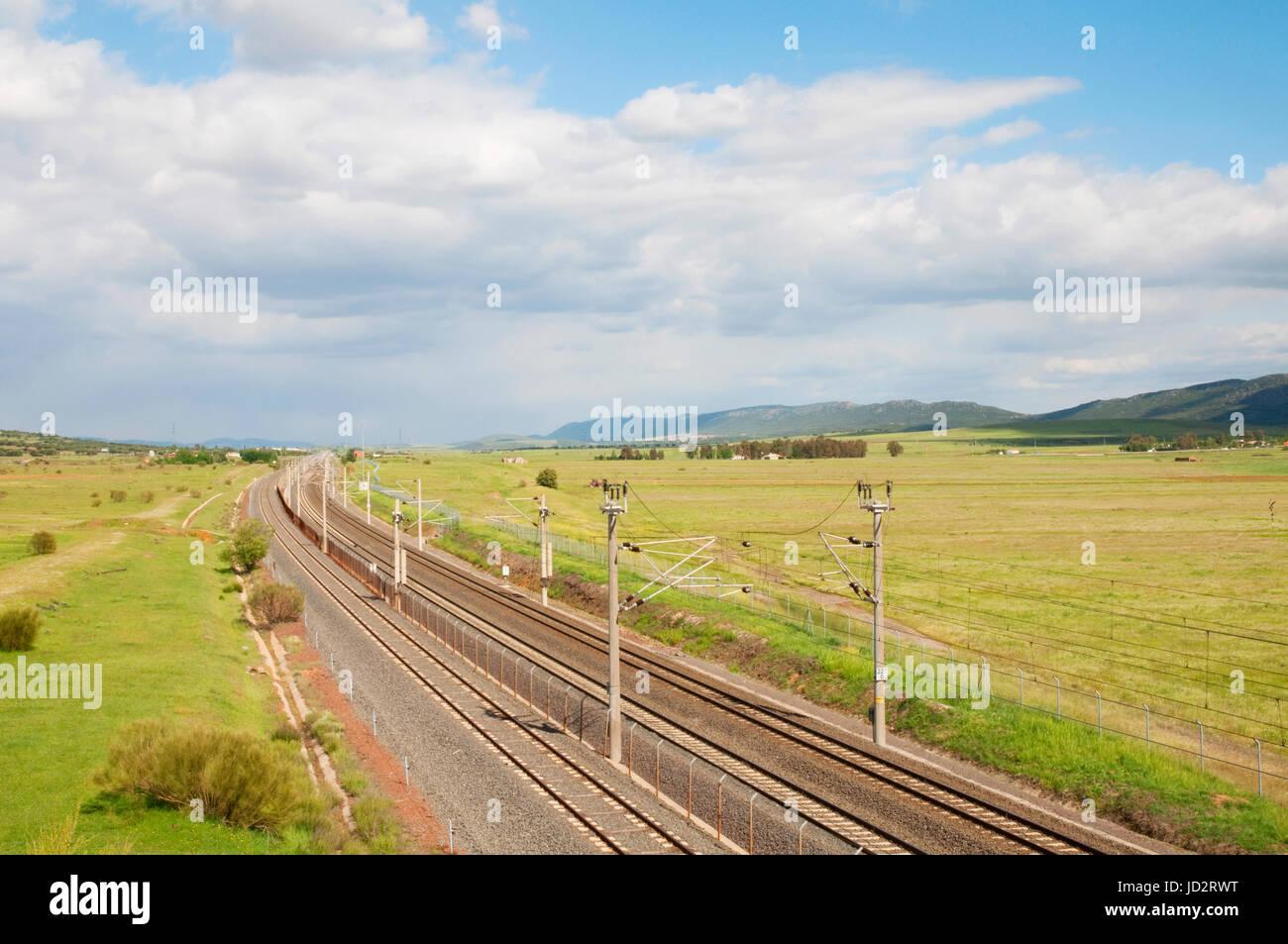 Railway tracks, AVE High-speed train Madrid-Sevilla. Puertollano, Ciudad Real province, Castilla La Mancha, Spain. - Stock Image