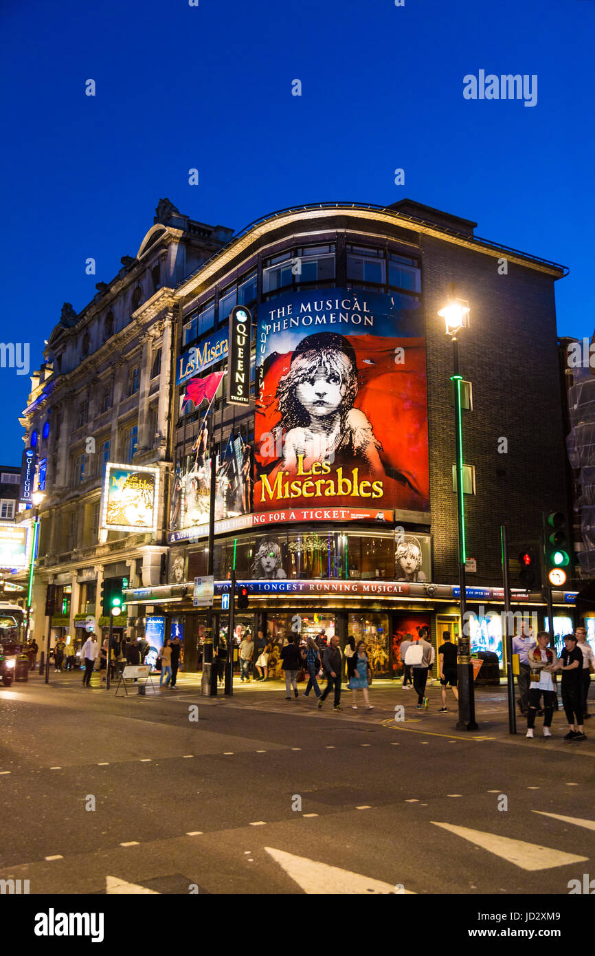 Queen's Theatre playing Les Miserables at night in Piccadilly, London, UK - Stock Image