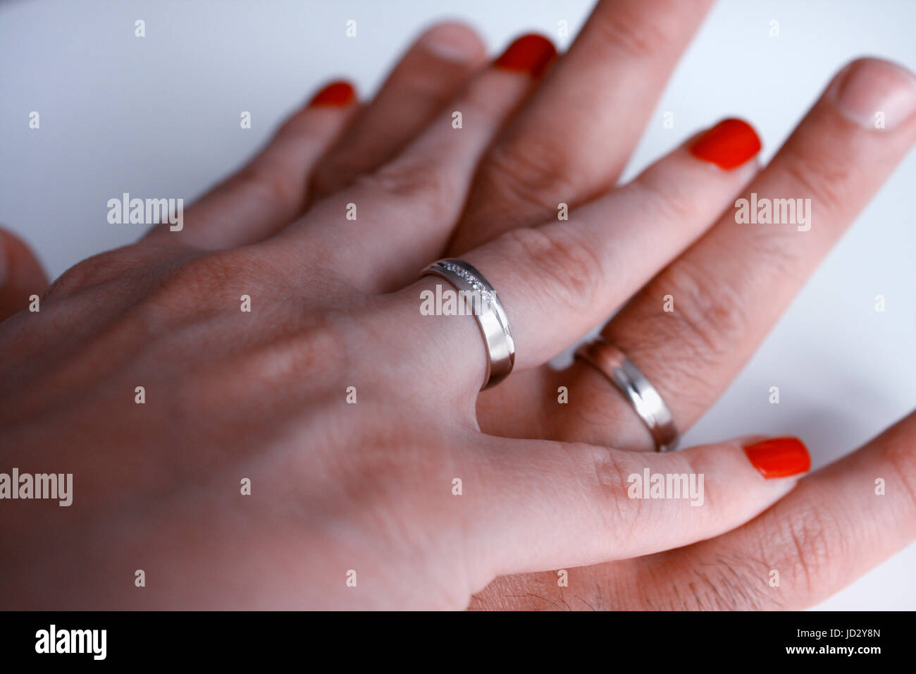 Golden Wedding Rings And Couple Hands Stock Photo 145738789 Alamy