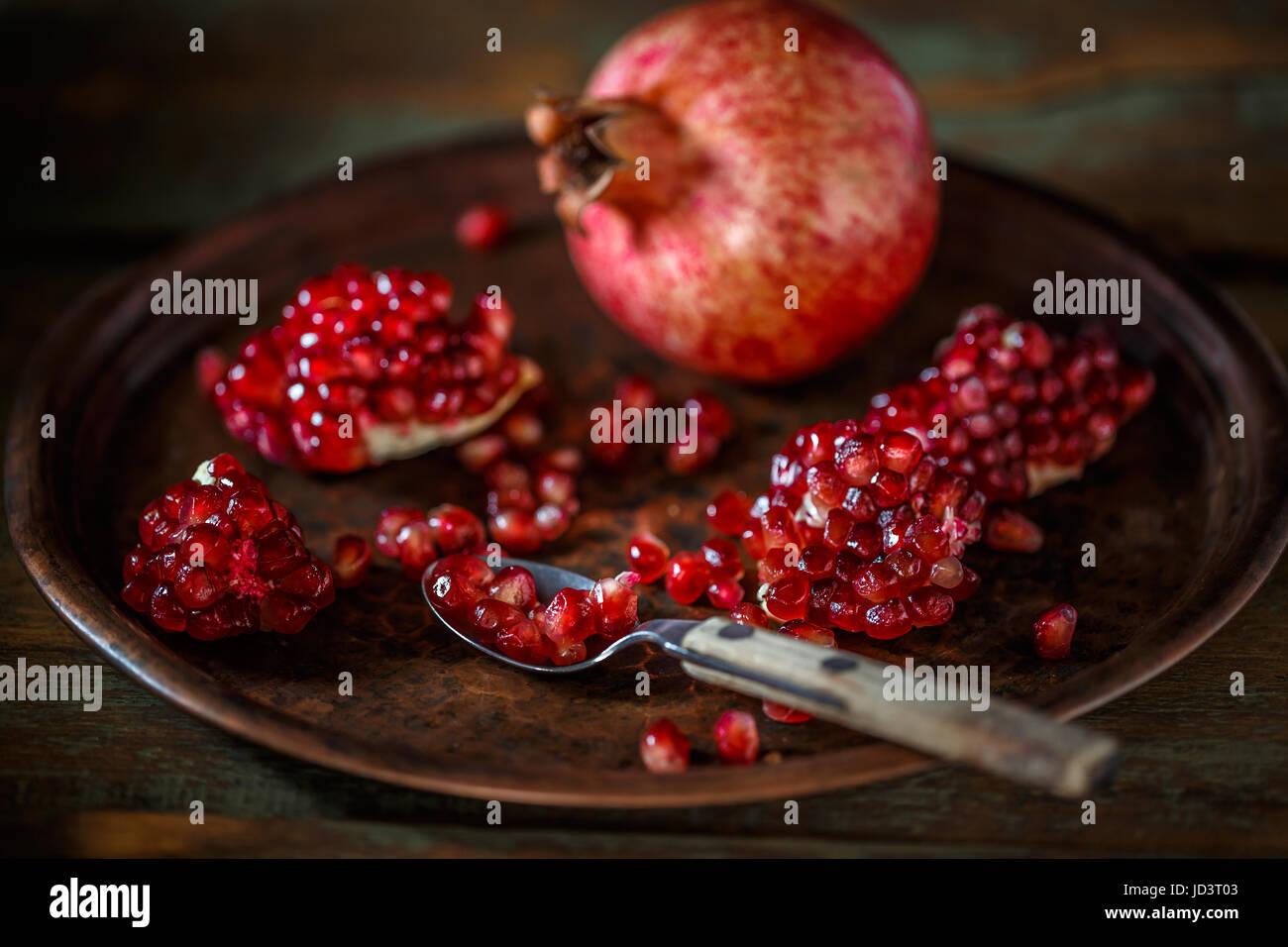 Ripe pomegranate fruit on  vintage background - Stock Image