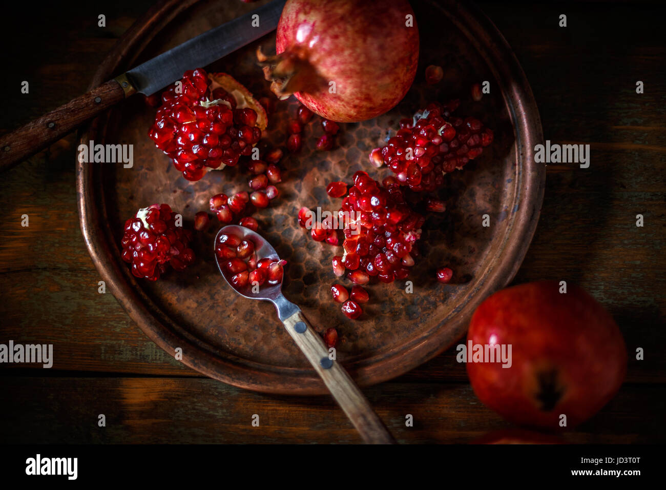 Broken and whole red ripe juicy pomegranates Stock Photo