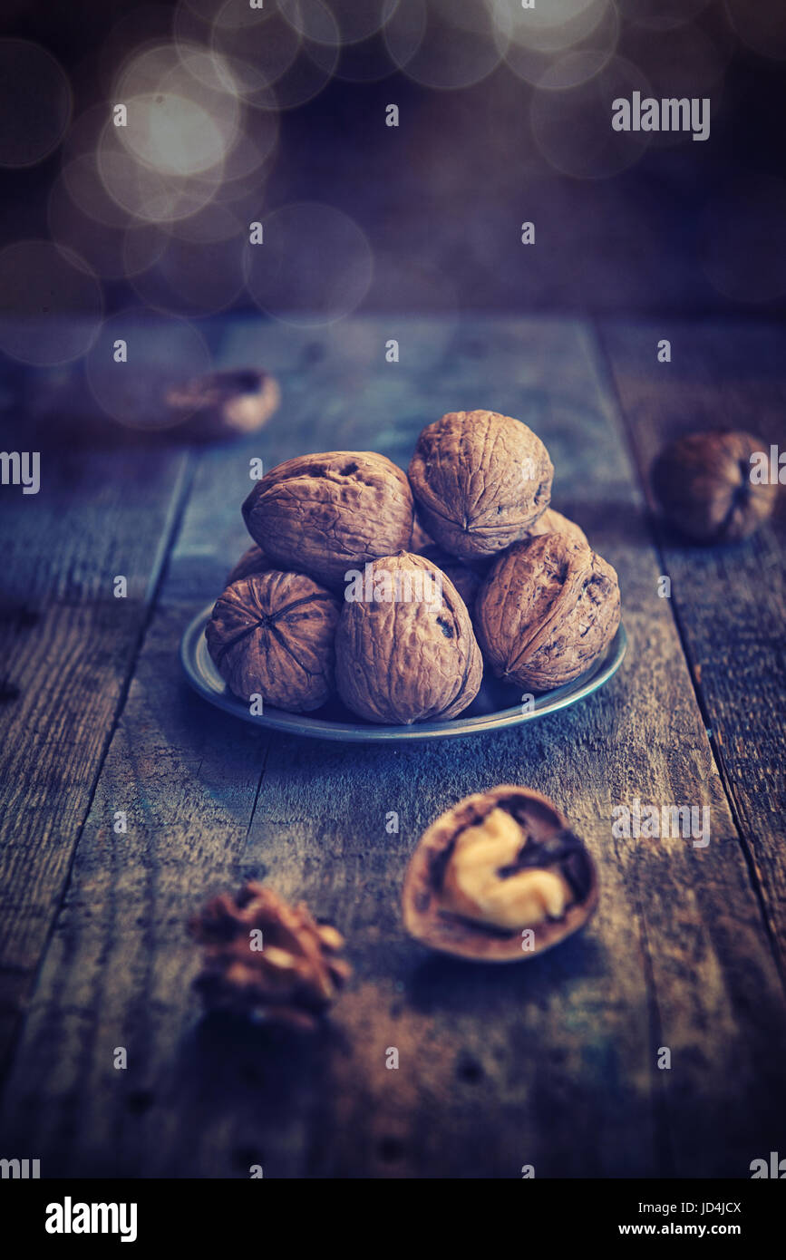 walnuts on wood aces rustic table background - Stock Image