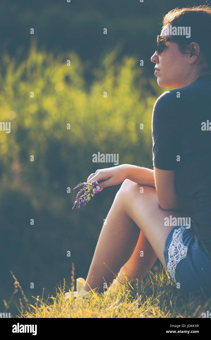 Relaxing woman in nature - Stock Image