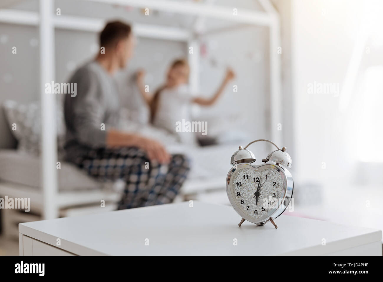 Active family waking up early in the morning - Stock Image