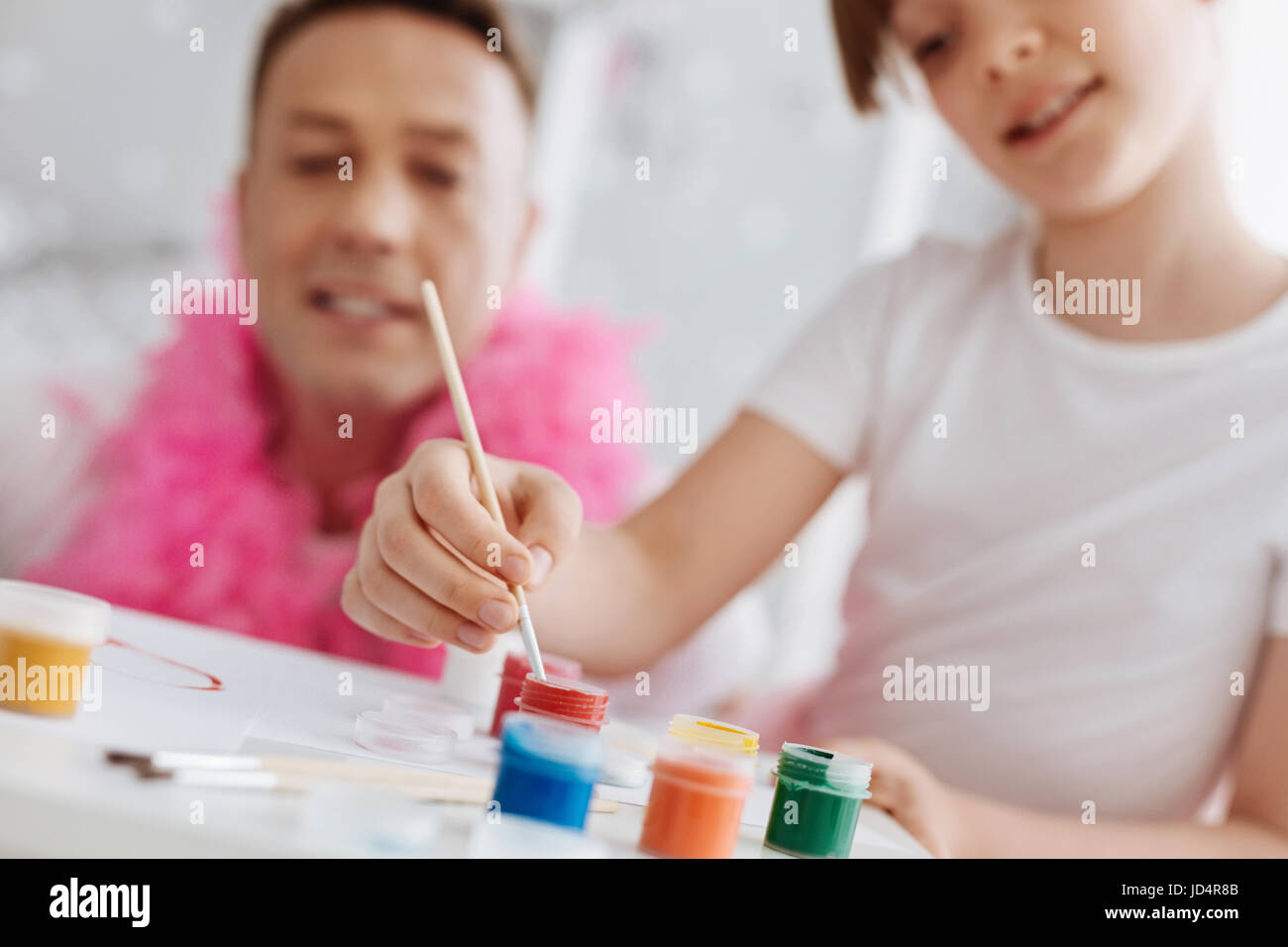 Supportive motivated parent guiding his child - Stock Image