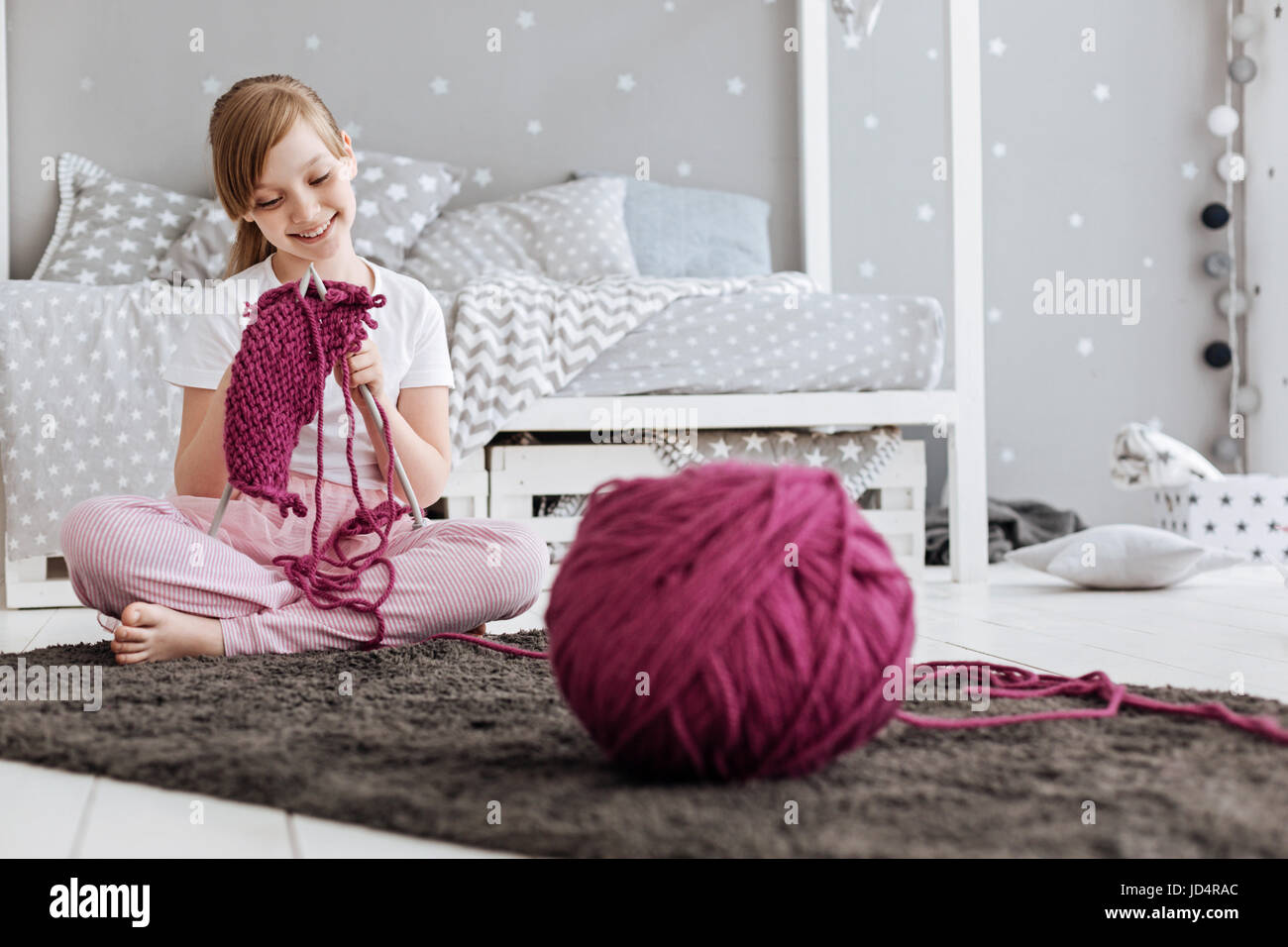 Incredible girl creating something with her own hands - Stock Image