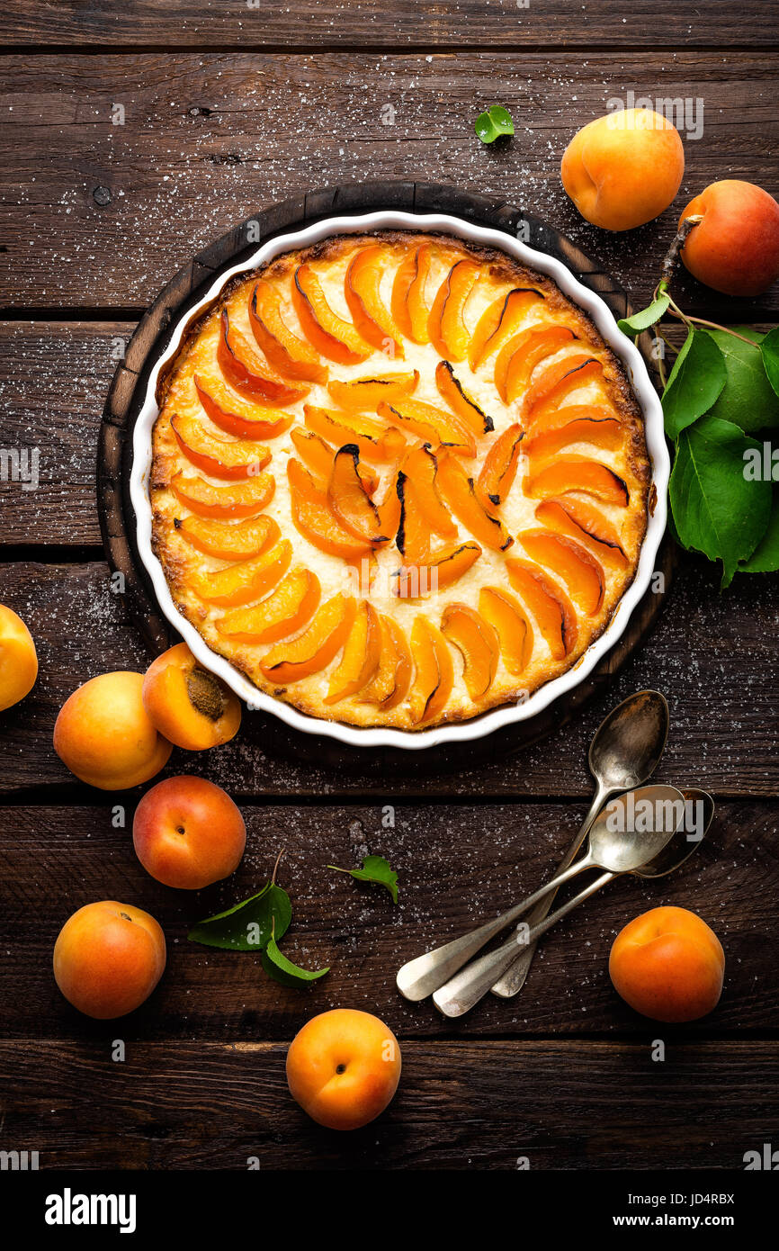 Apricot cake or pie with fresh fruits, cheesecake - Stock Image