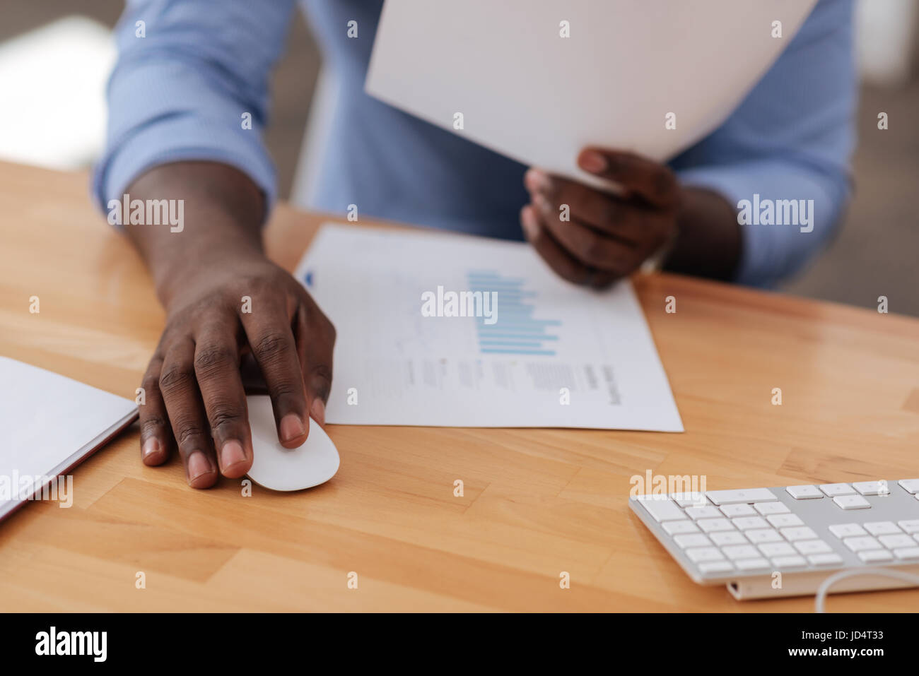 Nice Afro american man using a computer mouse - Stock Image