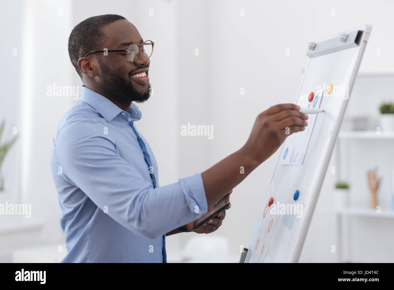 Positive creative man presenting a report - Stock Image