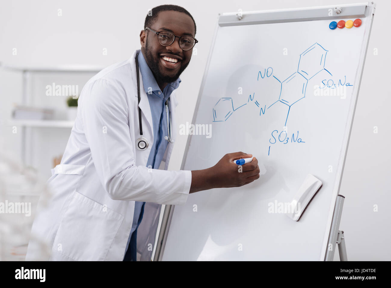 Delighted smart man studying organic chemistry Stock Photo