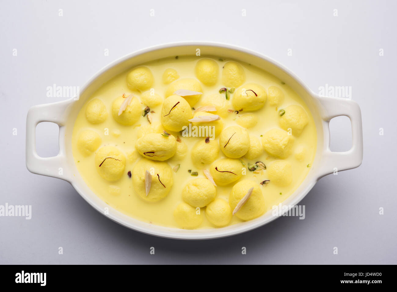 Angoori rasmalai or anguri ras malai is an Indian dessert. Made from cottage cheese which is then soaked in chashni, - Stock Image