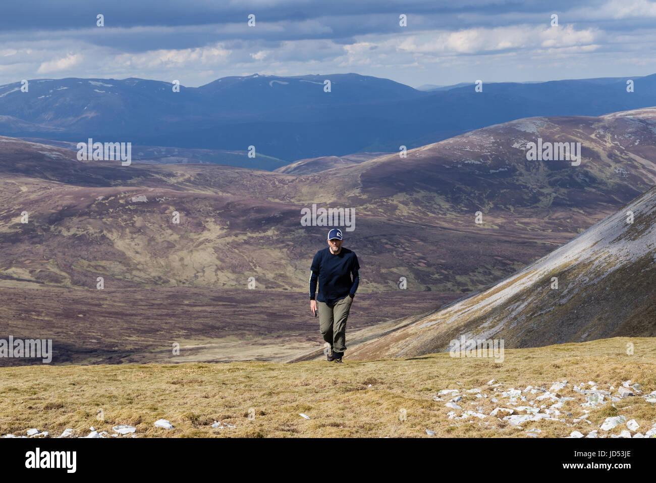 Hill walker on Beinn Iutharn Mhor - Stock Image