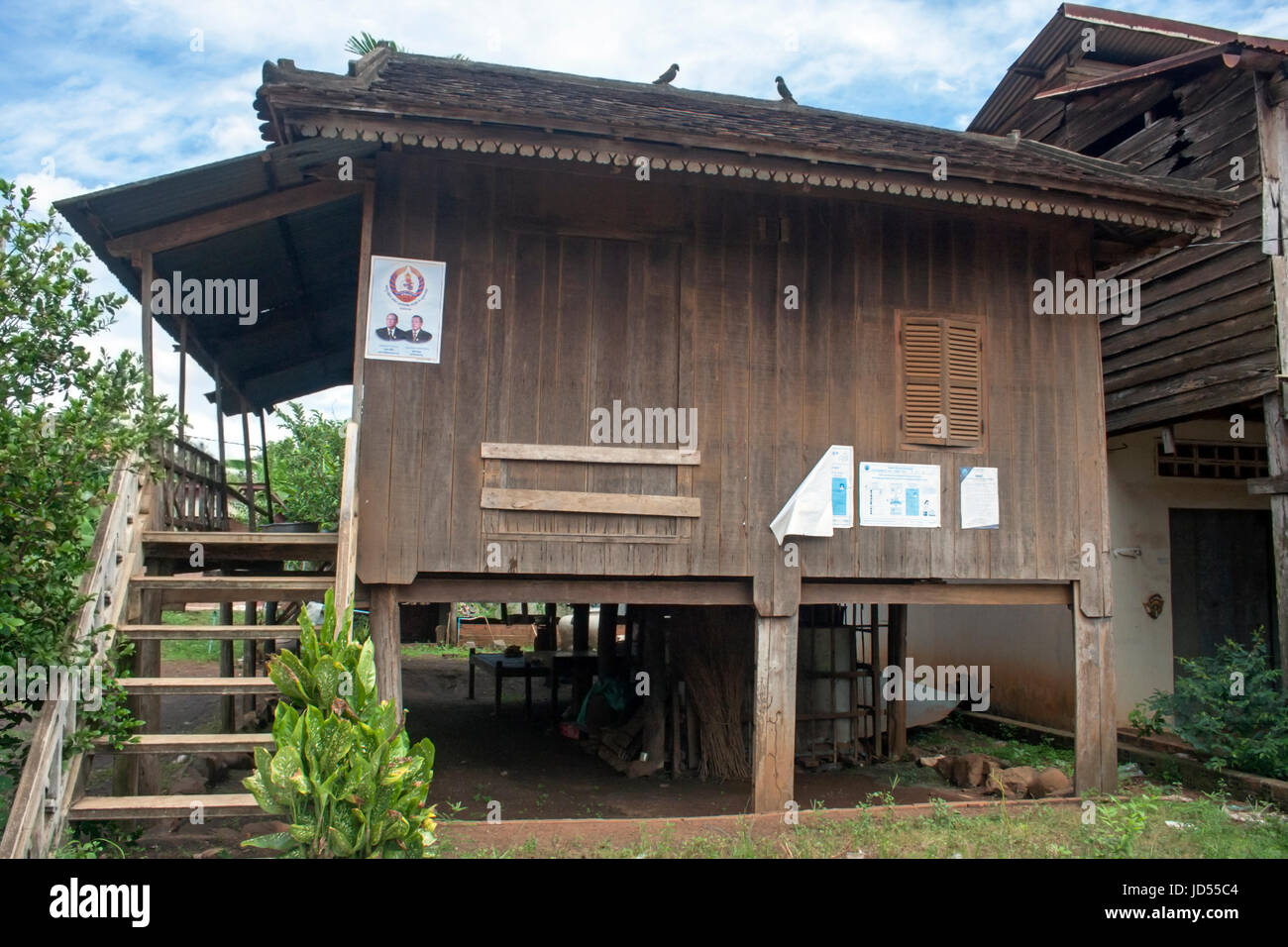 A stilted wooden house is part of the village landscape in Chork village, Tboung Khmum Province, Cambodia. Stock Photo