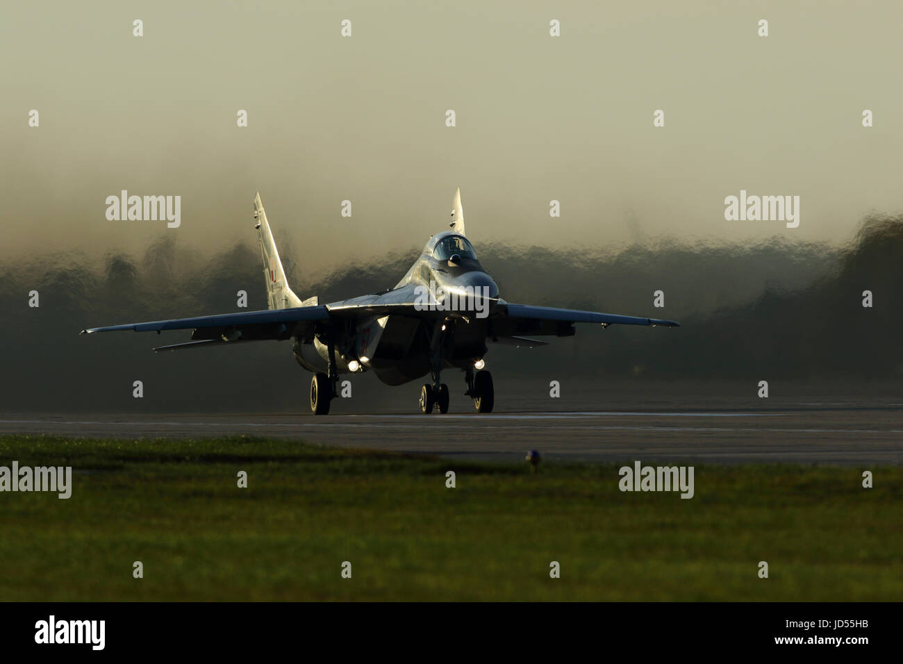 Mikoyan Gurevich Mig 29 Fulcrum Polish air force taking off at dusk at Mińsk Mazowiecki 25 miles from Warsaw Poland Stock Photo