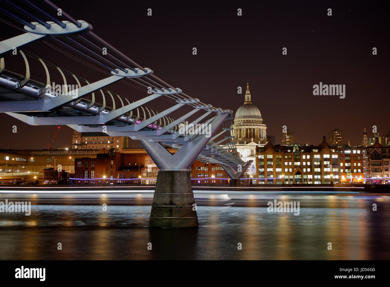 St Pauls cathedral and the Millennium footbridge across the Thames in London UK - Stock Image