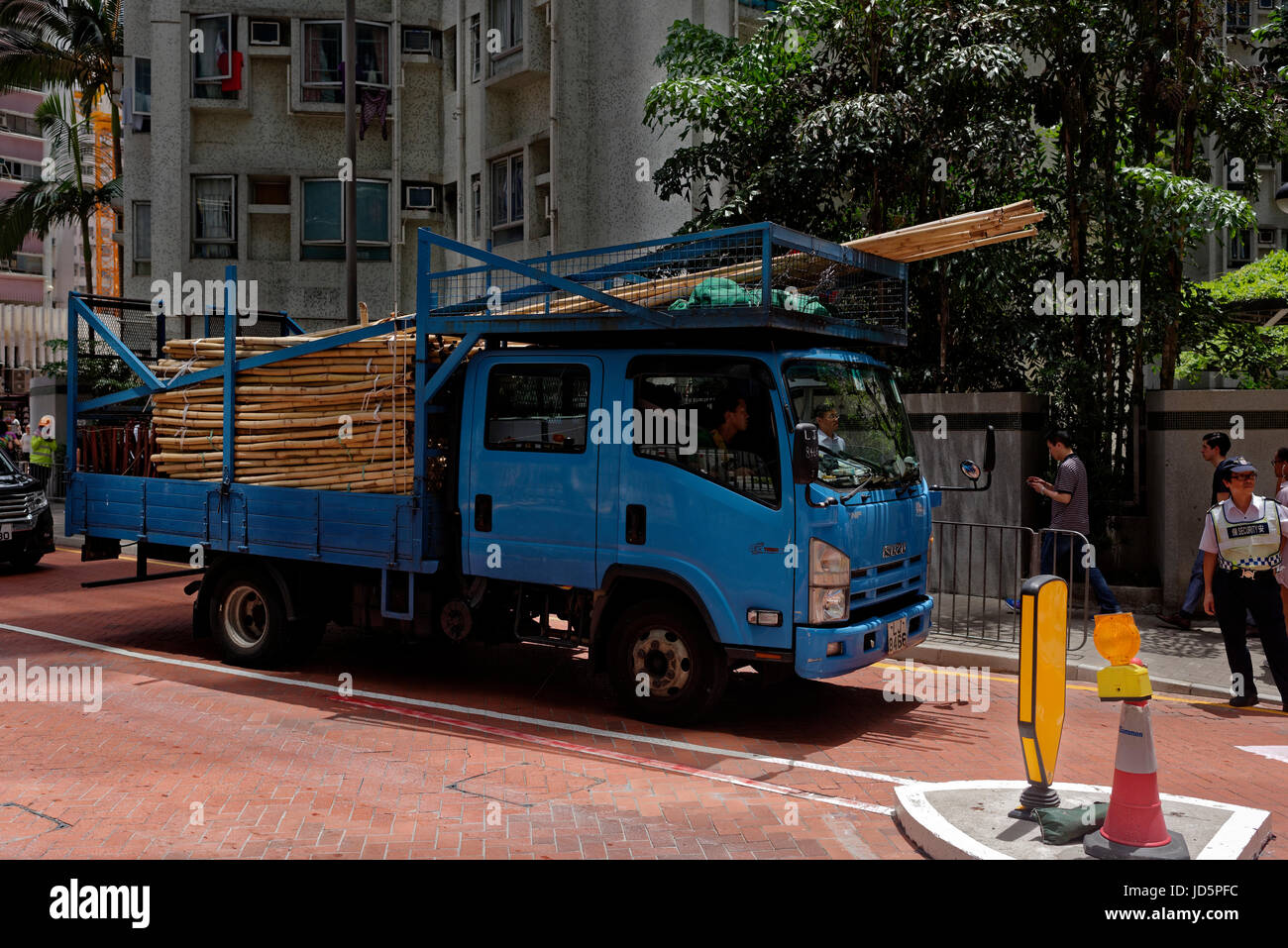 Delivery truck for bamboo scaffolding in Taikoo, Hong Kong - Stock Image