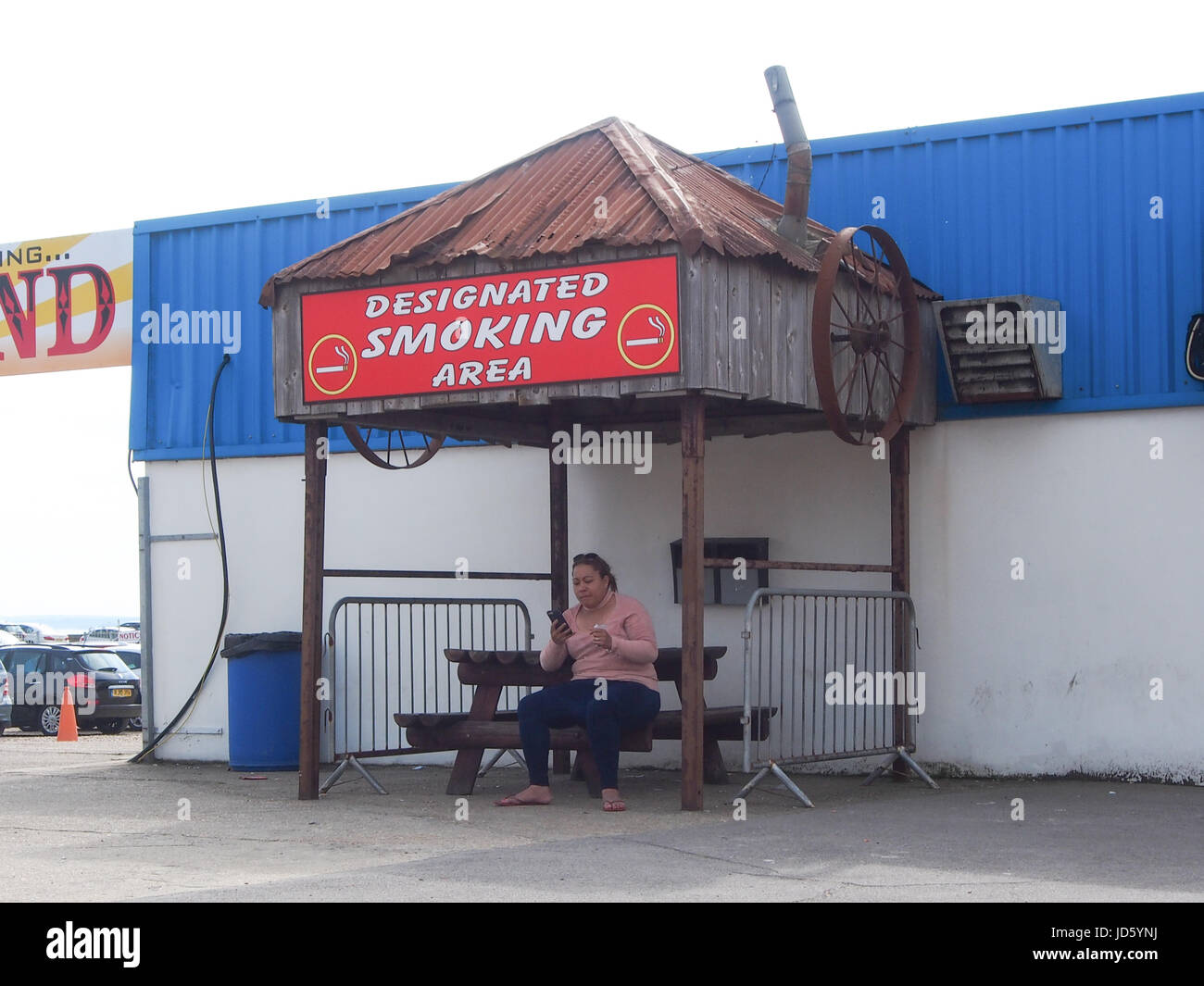 A designated smoking area at a children's funfair - Stock Image