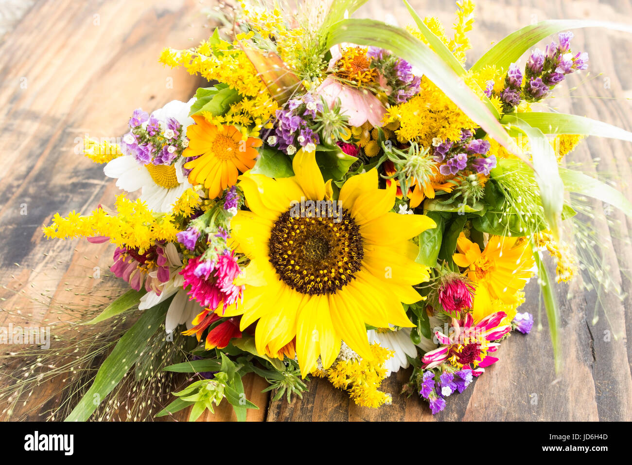 Fresh Bouquet Of Summer Flowers On A Rustic Wooden Background