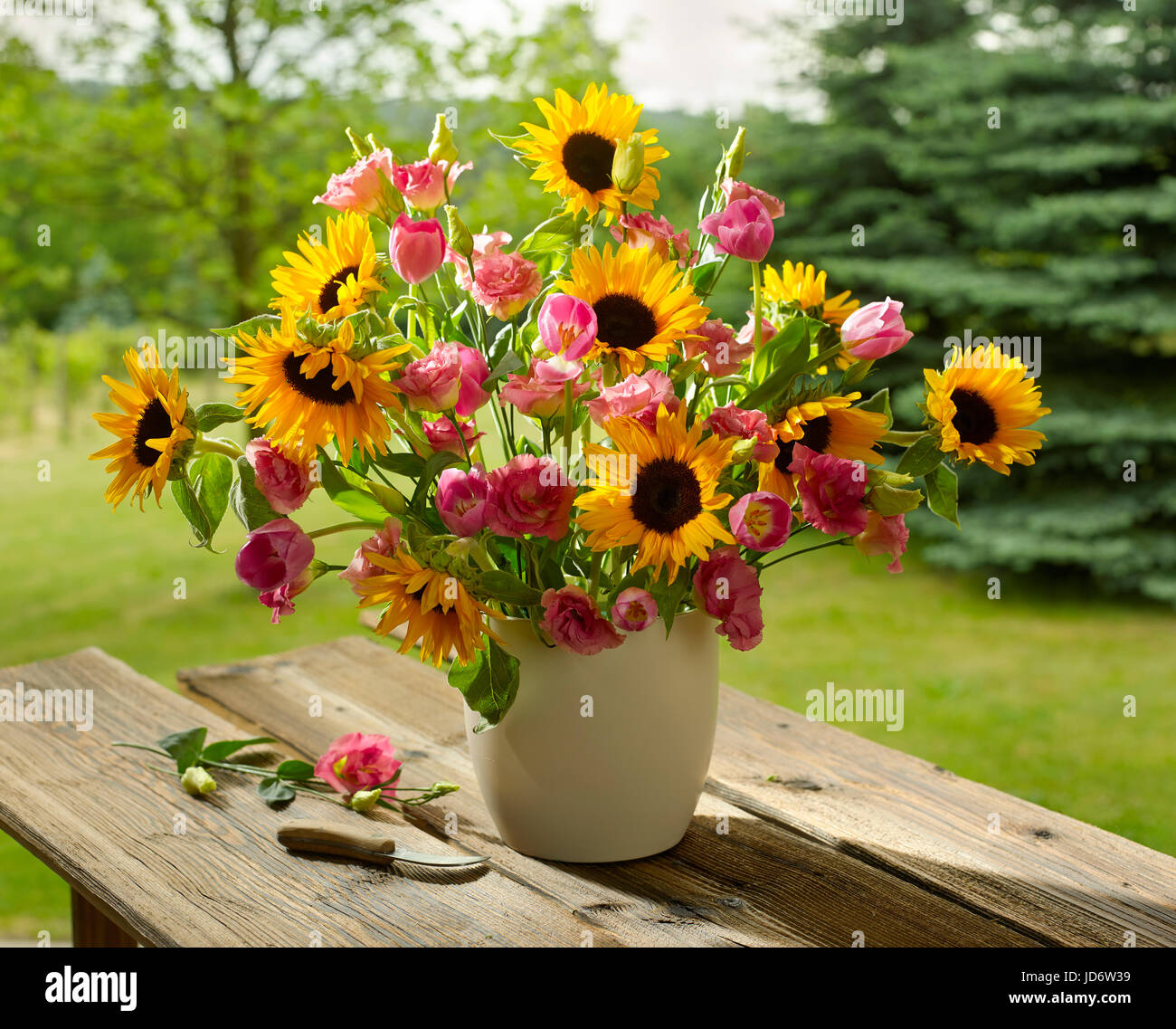 Bouquet Of Flowers With Sunflowers And Tulips Stock Photo