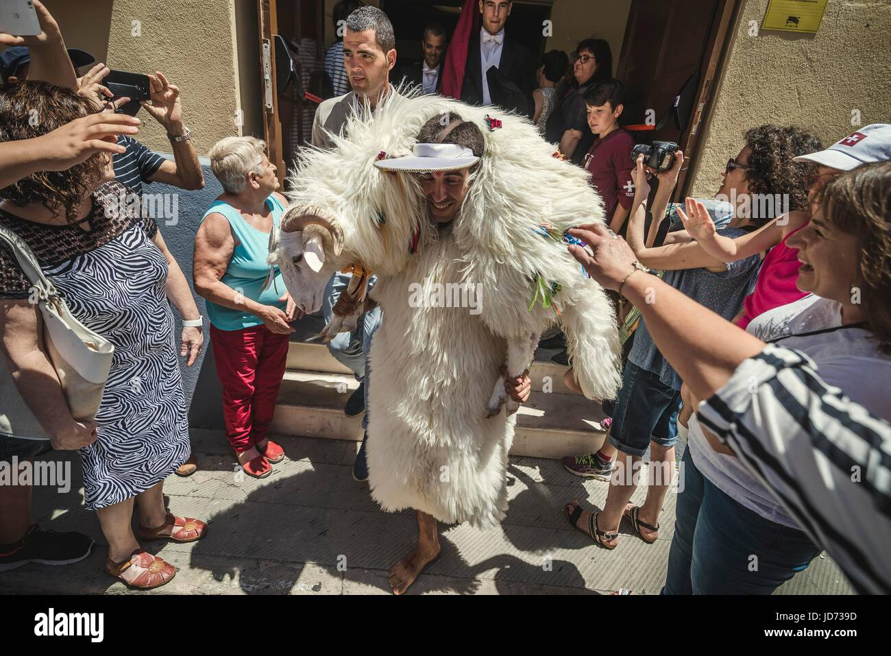 Ciutadella, Menorca. June 18th, 2017: People are looking for luck as the try to touch the docile sheep carried by - Stock Image