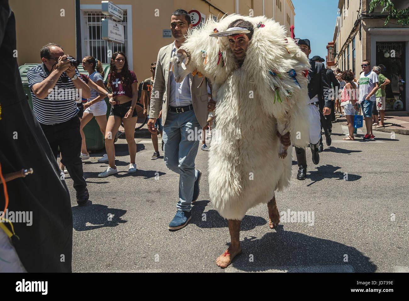 Ciutadella, Menorca. June 18th, 2017: A young man clad in a sheepskin, the 's'Homo des Be' (sheepman), - Stock Image