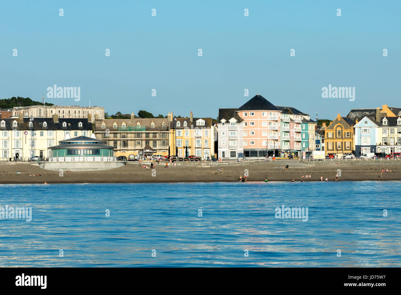 Aberystwyth seafront properties and bandstand, with people on the beach - Stock Image