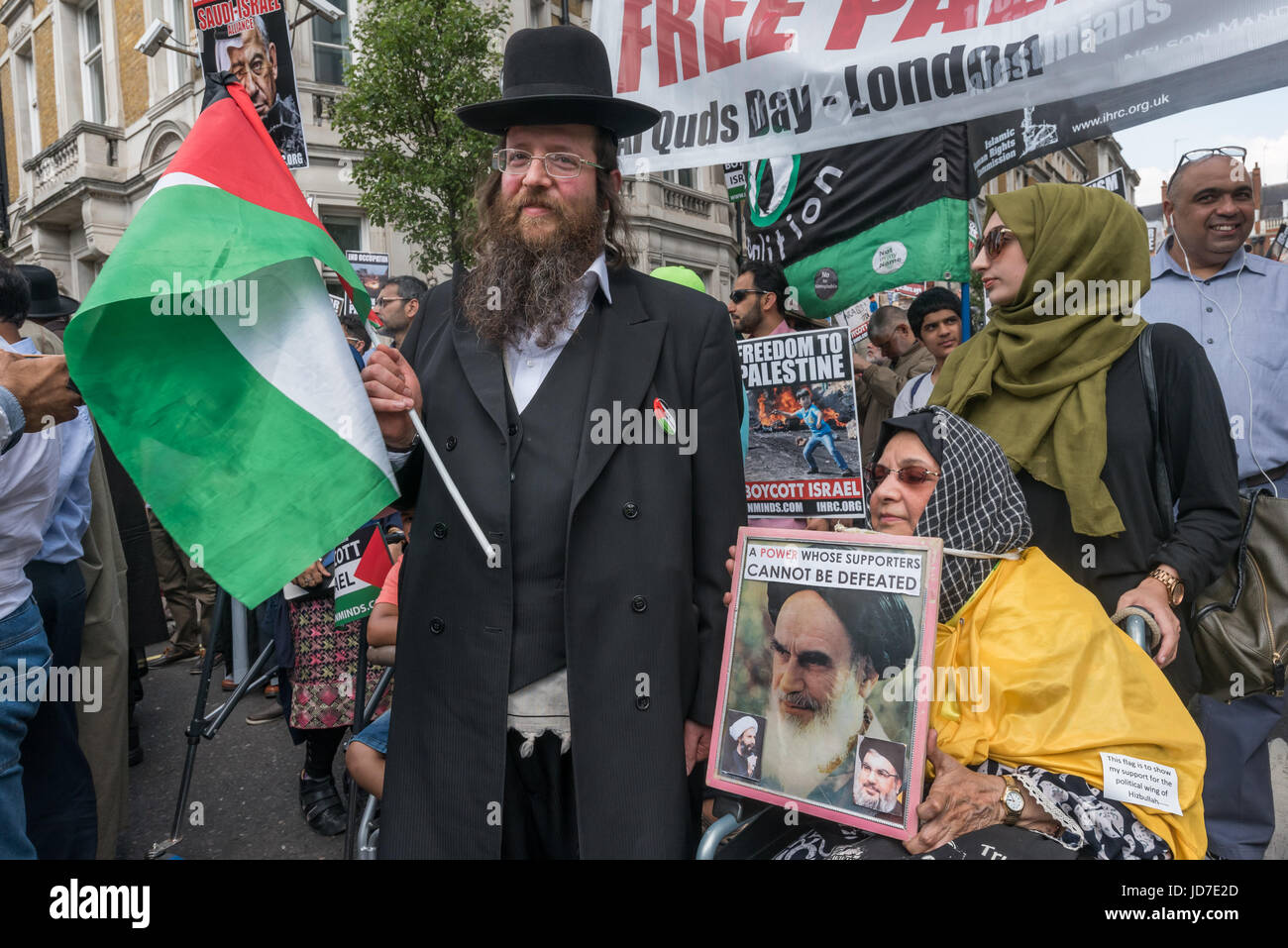 June 18, 2017 - London, UK - London, UK. 18th June 2017. A Neturei Karta Jew poses with a supporter of Ayatollah Stock Photo