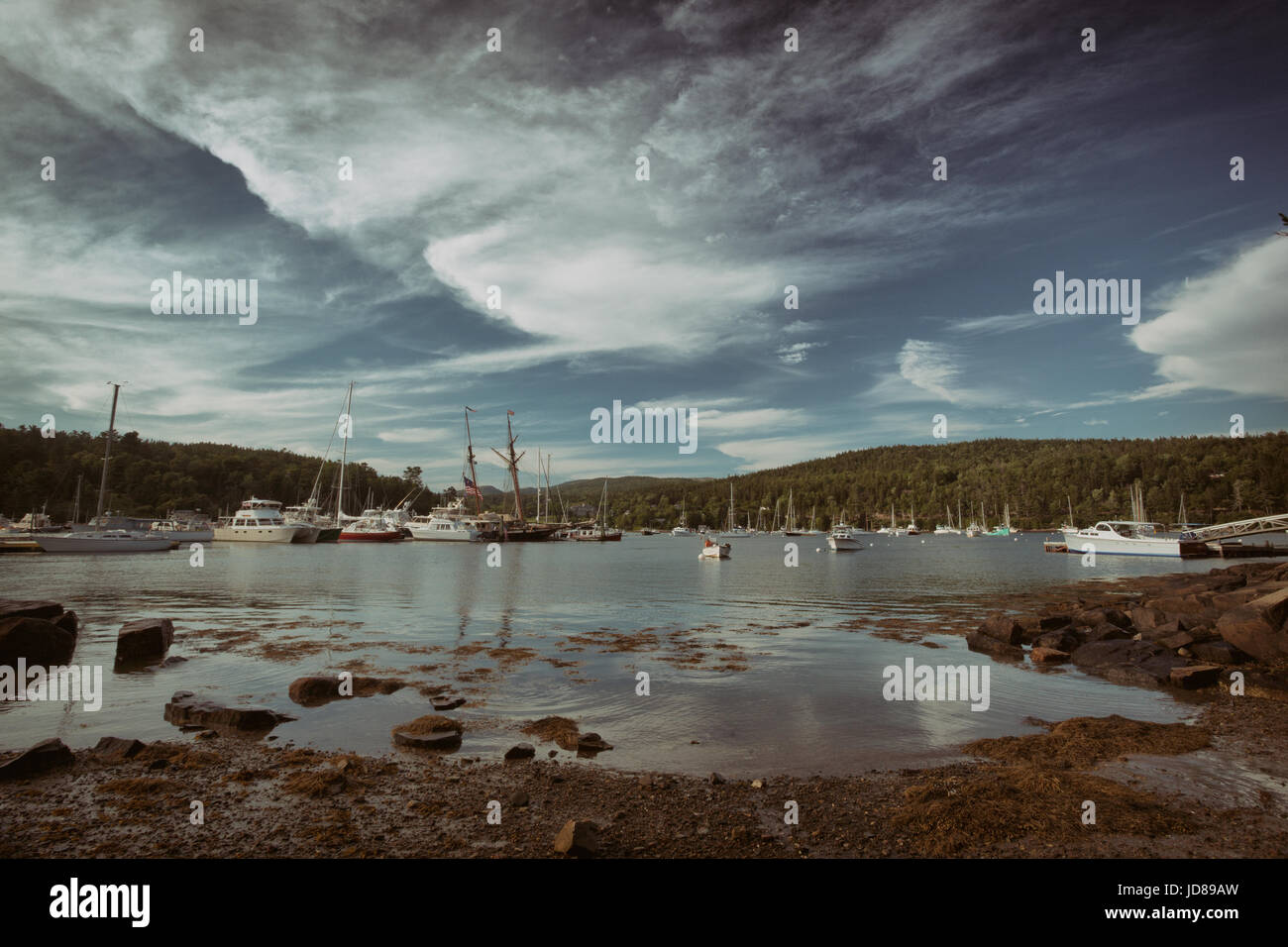 Boats lay idle in Northeast Harbor on Mount Dessert Isle in Maine. - Stock Image