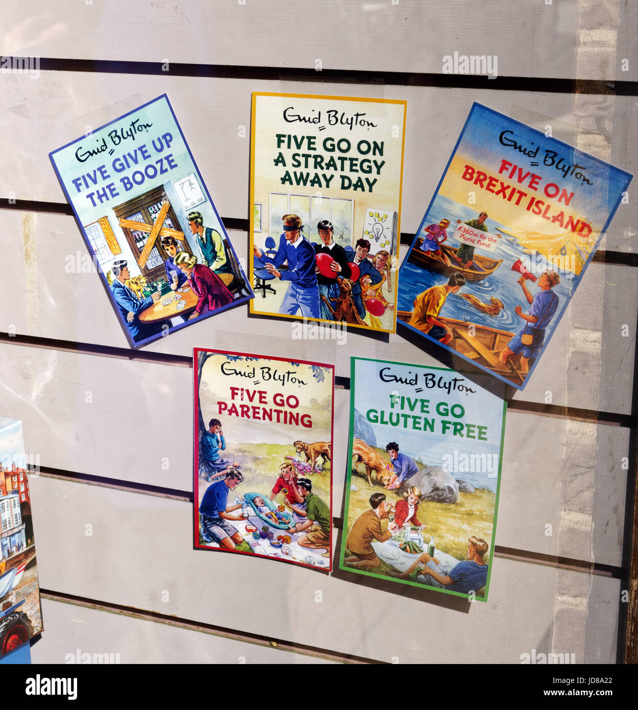 Humourous new editions of Enid Blyton's Famous Five books, including Five go Gluten Free and Five Give up the - Stock Image