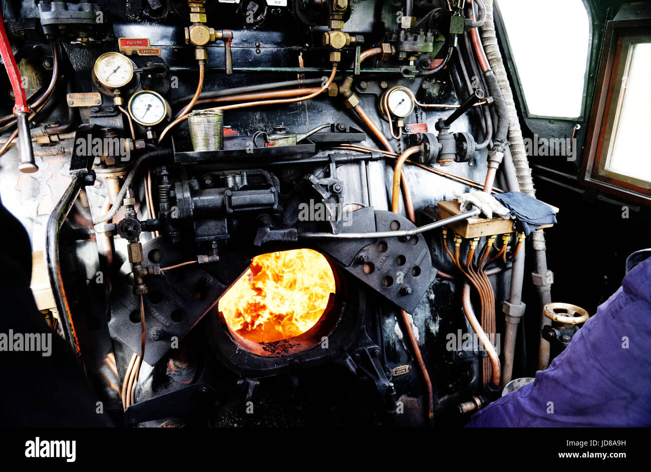 The fire burning in the boiler of the Battle of Britain class locomotive Manston 34070 - Stock Image