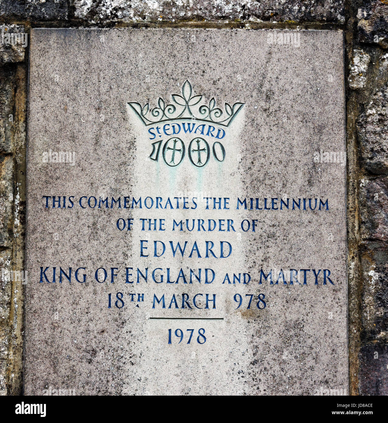 A stone in Corfe Castle to commemorate the millennium of the murder of King Edward the Martyr of England in 978 - Stock Image