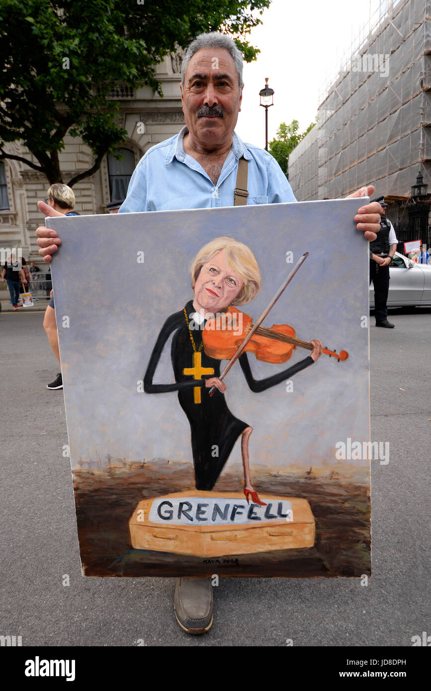 Kaya Mar artist. Theresa May playing over Grenfell victim coffin. Anti Tory DUP alliance demonstration outside Downing - Stock Image
