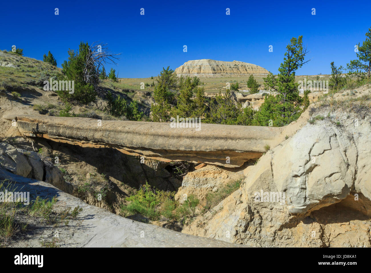 natural bridge in the terry badlands along the calypso trail near terry, montana - Stock Image