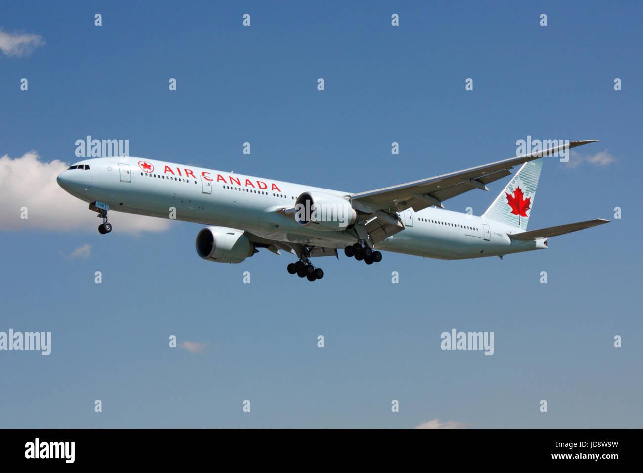 Commercial aviation and transatlantic flight. Air Canada Boeing 777-300ER long haul passenger jet plane on approach Stock Photo