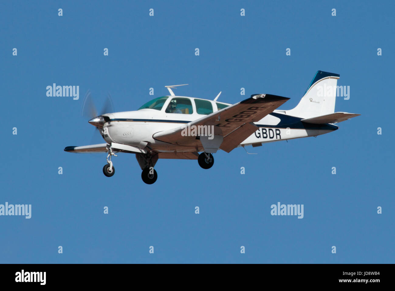 Beechcraft F33A Bonanza single-engine light private plane on approach - Stock Image