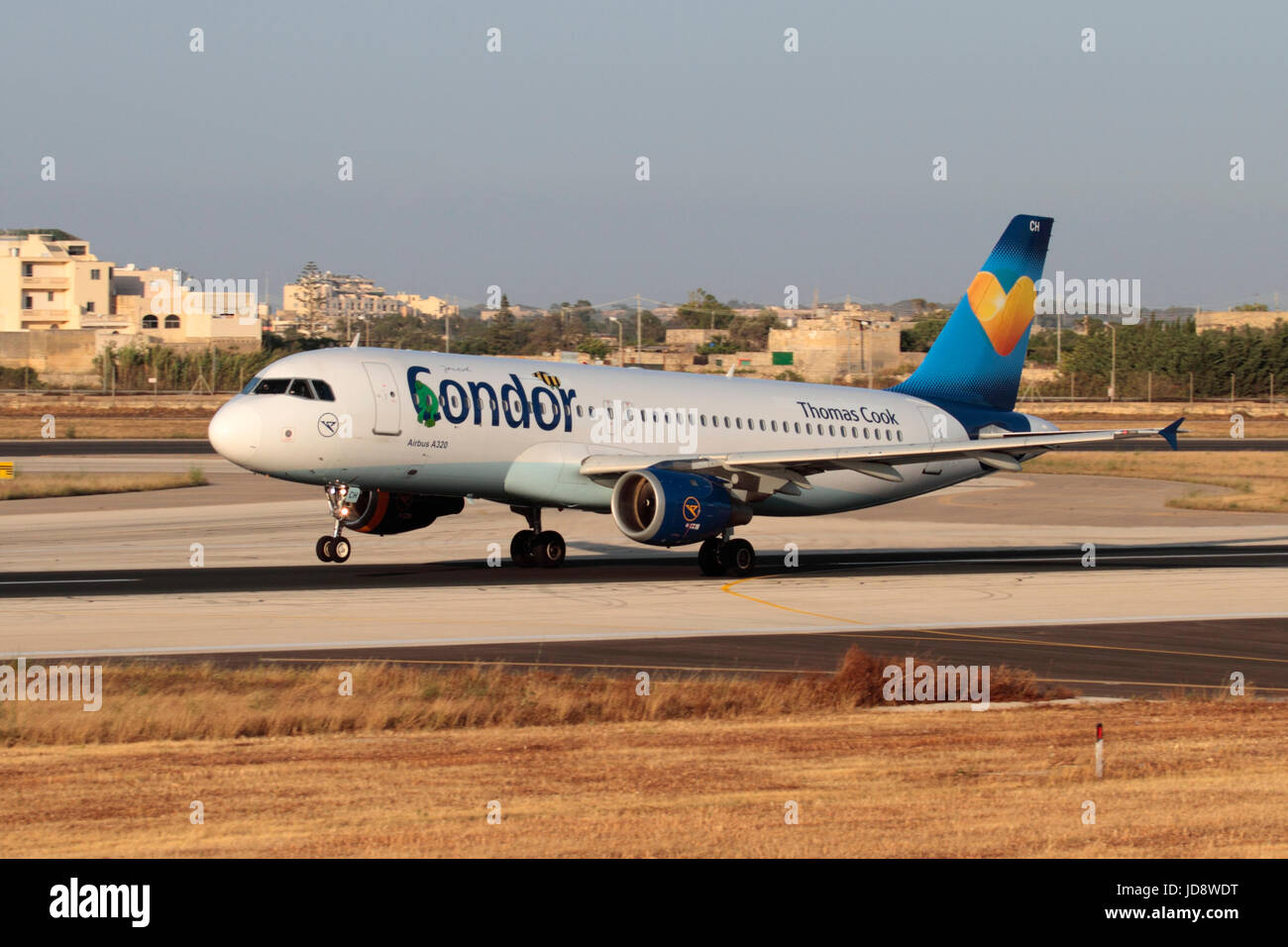 Commercial air travel. Condor Flugdienst Airbus A320 passenger jet plane taking off from Malta - Stock Image