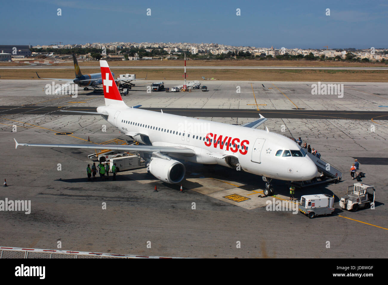 Commercial air travel in Europe. Passengers boarding a Swiss International Air Lines Airbus A320 jet plane on the - Stock Image