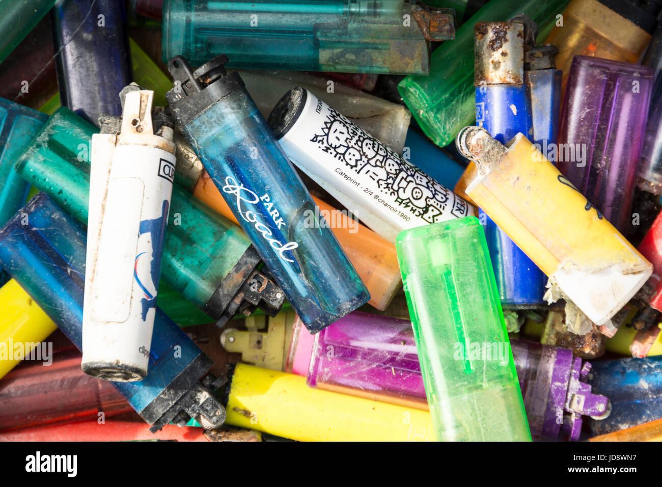 Discarded disposable plastic lighters - Stock Image