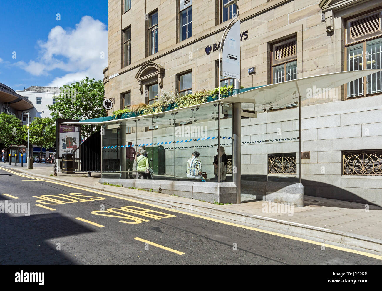 Bus shelters at Barclays Bank in Crichton Street in Dundee Tayside Scotland UK - Stock Image