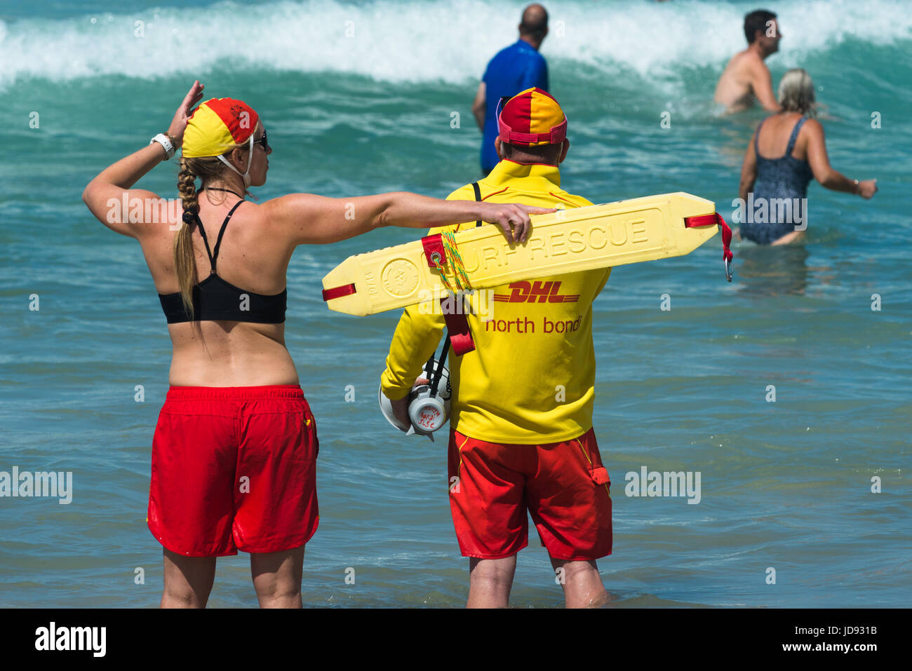 Lifeguards actively watching bathers ahead as the waves hit. Bondi beach. Sydney, Australia. - Stock Image