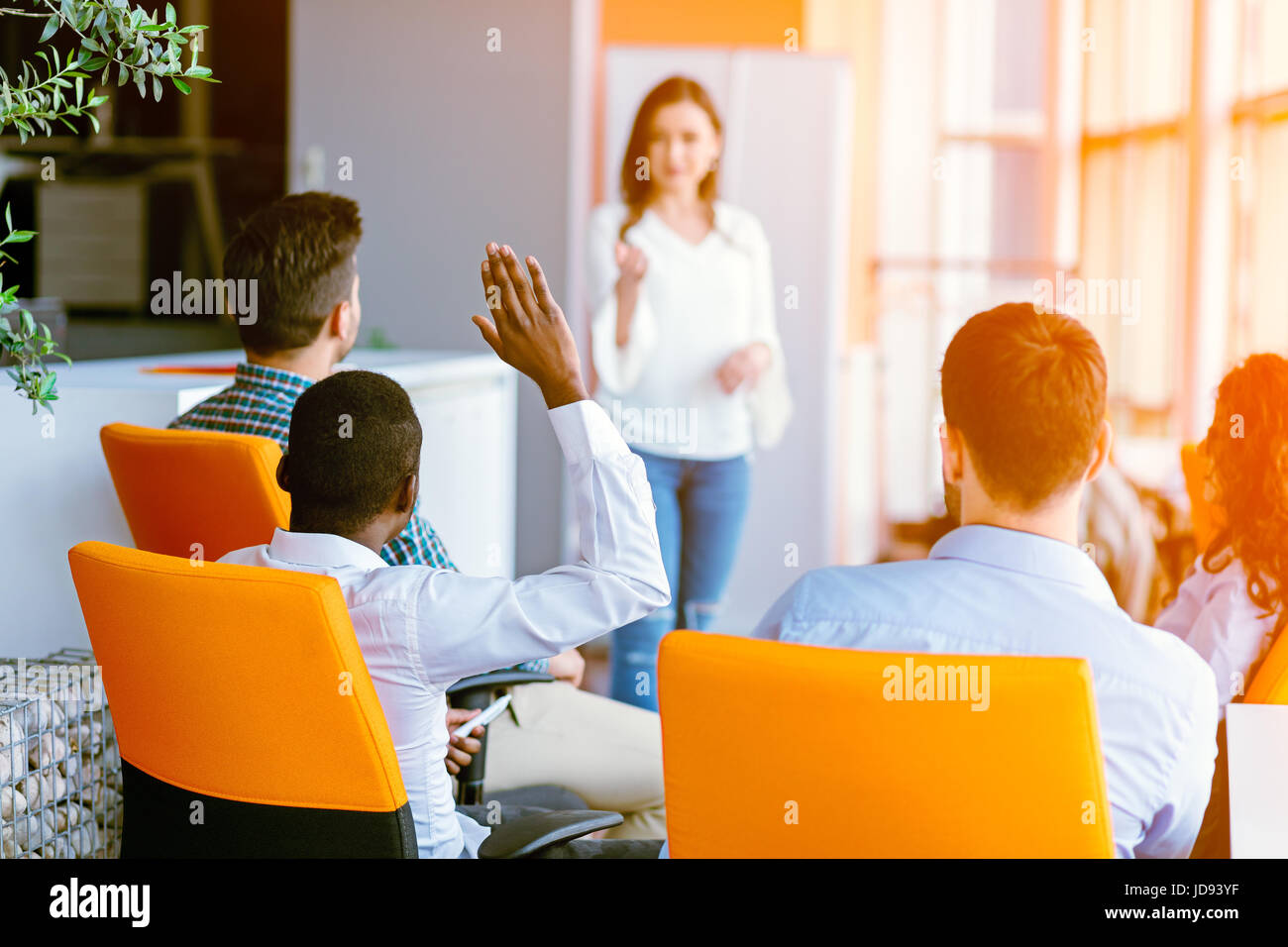 African american Business people Raising there Hand Up at a Conference to answer a question - Stock Image