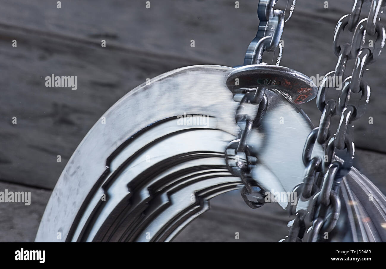 Chains Lifting Heavy Metal With Motion Blur - Stock Image