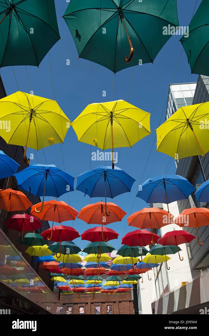 umbrellas in an array of colours decorating eden walk, a shopping precinct in kingston upon thames, surrey, england - Stock Image
