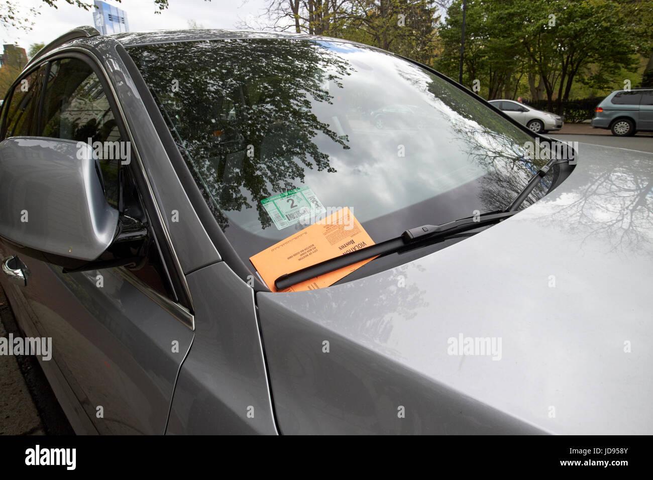 city of boston parking violation notice under windscreen wiper Boston USA - Stock Image