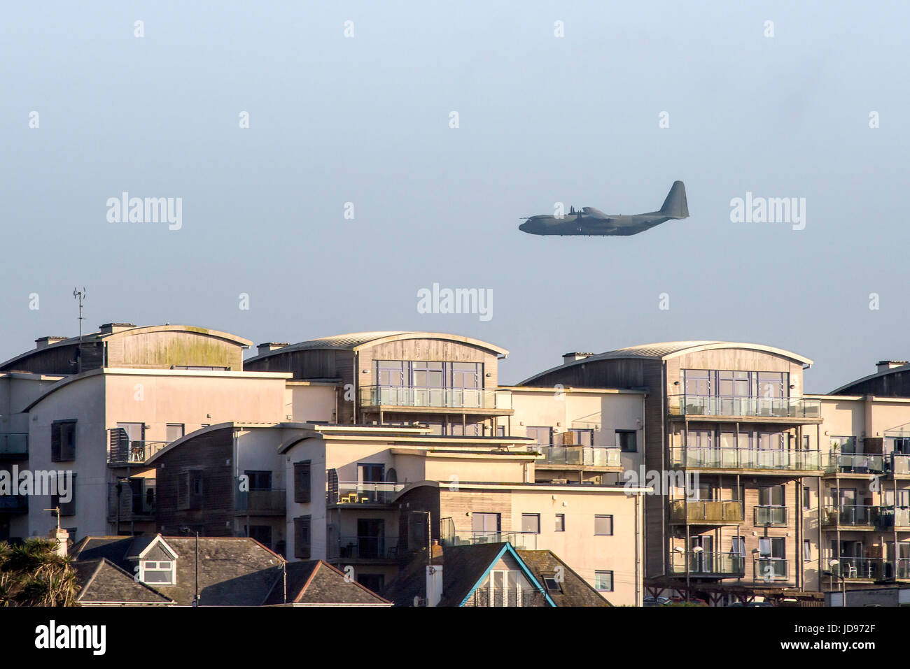 A Hercules C-130 tactical transport aircraft flying over Newquay, Cornwall. - Stock Image