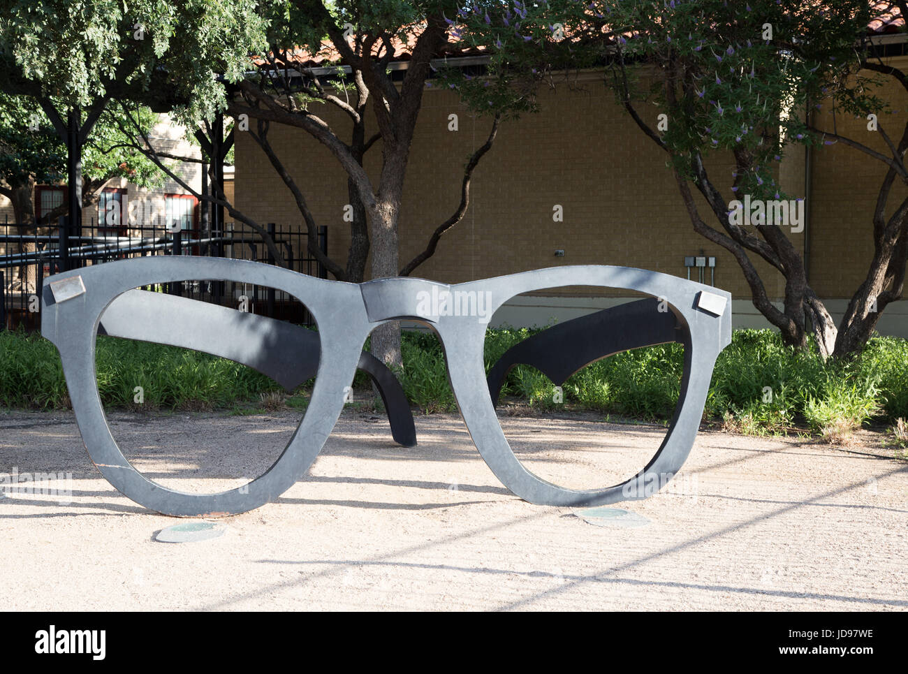 Buddy Holly's giant glasses greet visitors at the Buddy Holly Center - Stock Image